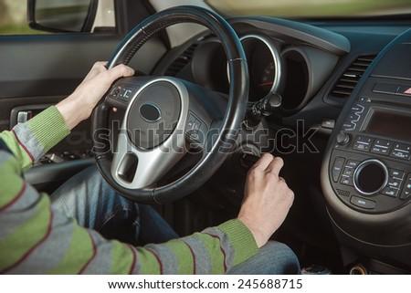man starts ignition - stock photo