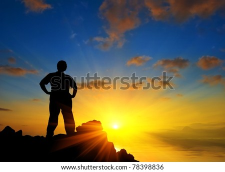 man stay on a marine cape at the sunset - stock photo
