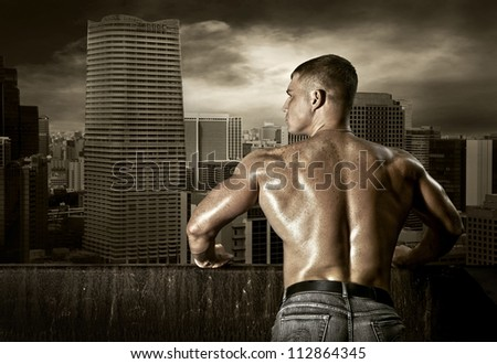 Man stay on the roof of skyscraper - stock photo