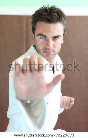 Man stood in martial art position - stock photo