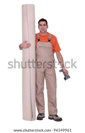 Man stood with carpet roll - stock photo