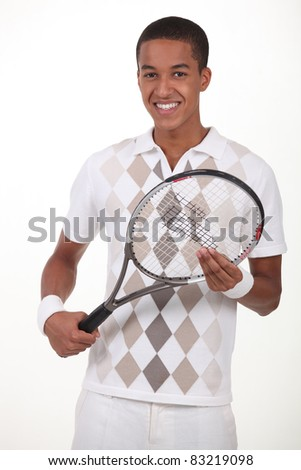 Man stood with tennis racket - stock photo
