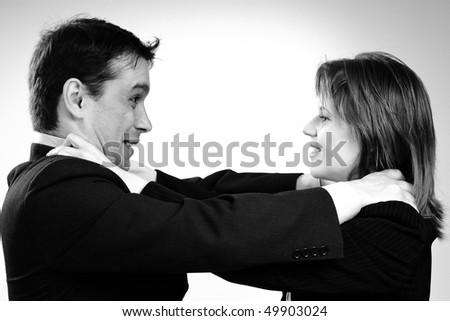 man strangling his colleague - stock photo