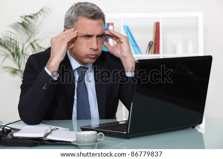 Man stressed with a laptop - stock photo