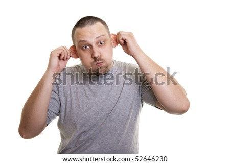 man stretches his ears  and make a monkey face - stock photo