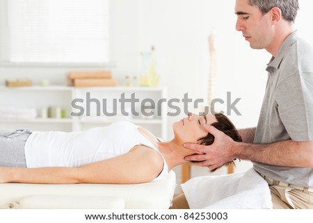 Man stretching a cute woman in a room
