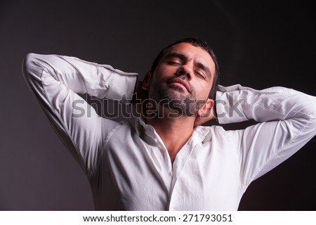 man stretching and relaxing - stock photo