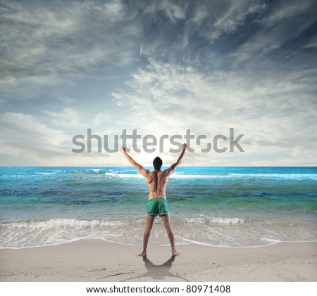 Man stretching at the seaside - stock photo