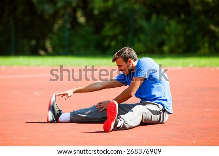 Man stretching body before jogging - stock photo