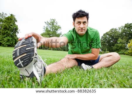 Man stretching his leg outdoors