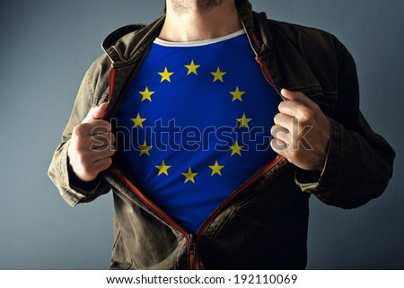Man stretching jacket to reveal shirt with European Union flag printed. Concept of patriotism and national team supporting. - stock photo