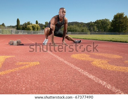Man stretching on track