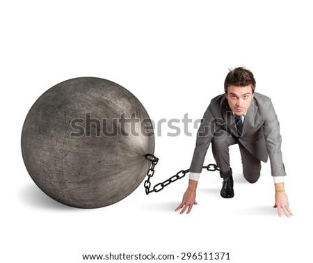 Man stuck in a challenge by an obstacle - stock photo