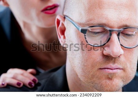 man suffering a harassment by a woman (focus on man) - stock photo