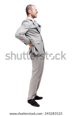 Man suffering for a backache full length - stock photo