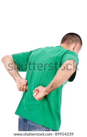 Man suffering from a kidney or back ache pain, isolated on white background - stock photo