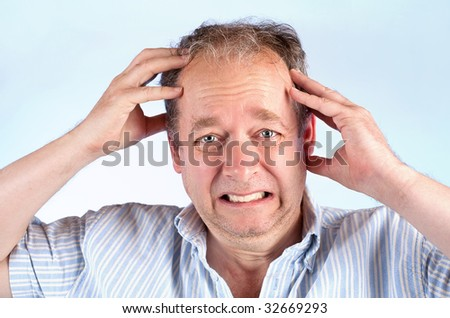 Man Suffering from a Migraine or Bad News - stock photo