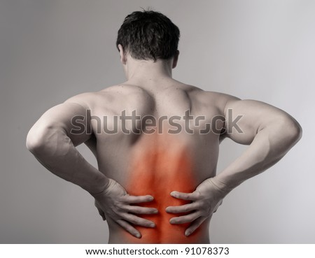 Man suffering from backache - stock photo