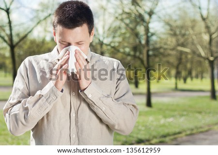 Man suffering from flu or allergy - stock photo