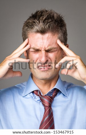 man suffering from headache - stock photo