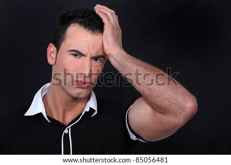 Man suffering from headache - stock photo