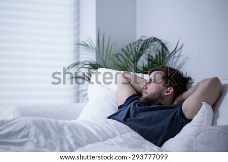 Man suffering from insomnia after sleepless night - stock photo