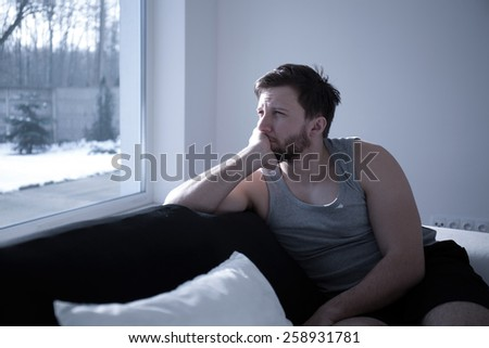 Man suffering from insomnia waking up early - stock photo