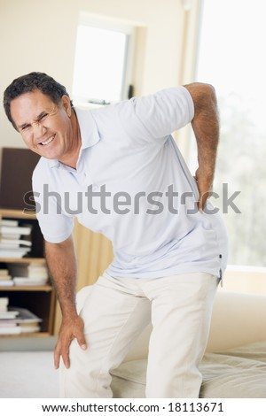 man suffering with backache - stock photo