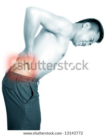 Man suffers from lower back pain. - stock photo