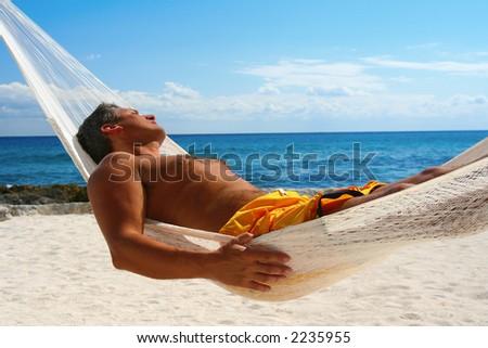 Man Sunbathing in a Hammock - stock photo
