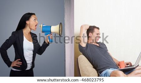 Man surfing the internet while angry woman calling him through a megaphone