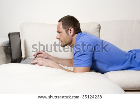 Man surfing the net at home