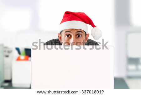 man surprised at the websites for travel deals on Christmas on Christmas - stock photo