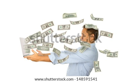 Man surprised by money fly out off laptop screen, isolated on white