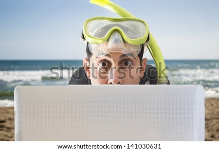 man surprised by the offers for your holidays and trips on the beach - stock photo