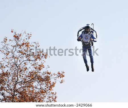 Man surprised crowd at the Tournament of Roses parade by flying through the air with a jet pack - stock photo