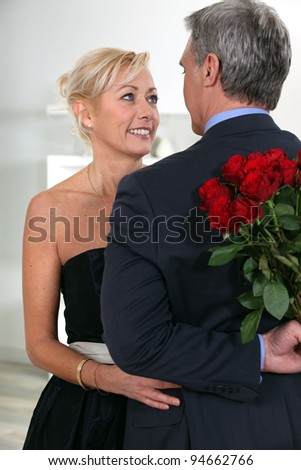 Man surprising his date with roses