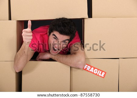 man surrounded by boxes