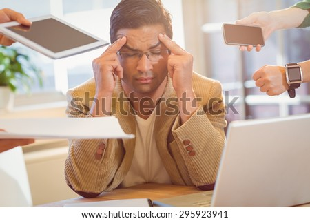 Man surrounding by work at the office - stock photo