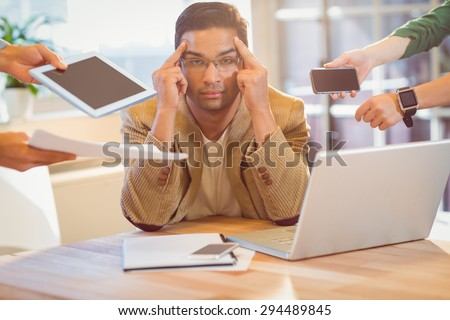 Man surrounding by work at work - stock photo