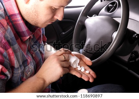 Man swallows drugs in the car