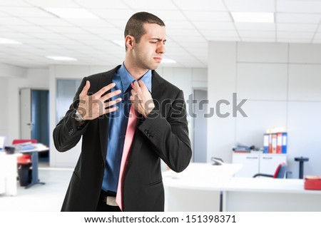 Man sweating in his office - stock photo