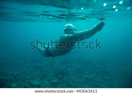 man swim underwater sea dive - stock photo