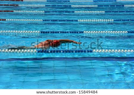 Man swimming in a pool lane - stock photo