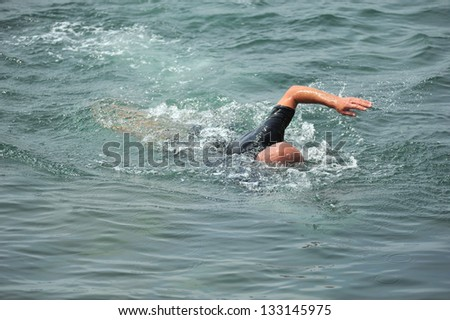 man swims