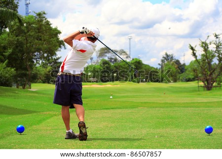 man swing golf in nice golf course. - stock photo