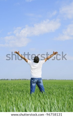 man take energy from nature in the meadow - stock photo