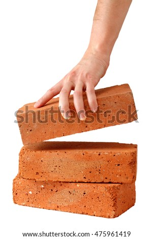 Man takes brick isolated on white background