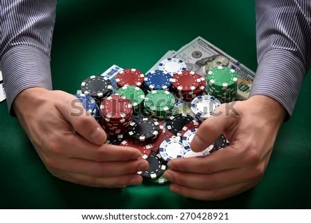 man takes Casino Jackpot, close up - stock photo