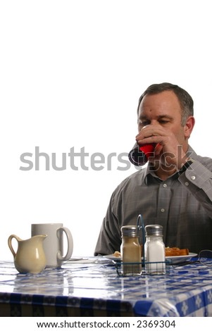 Man taking a drink at lunch - stock photo